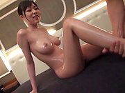 Big tits Japanese hottie gets oiled up and enjoys tits fucking