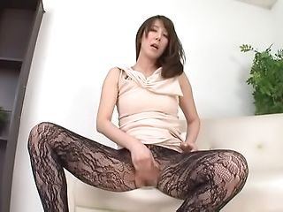 Enchanting amateur stimulating pussy in solo action