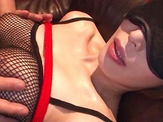 Big-tittied Asian sex doll Kimijima Mio plays with two cocks
