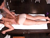 Masseur enjoys rubbing woman's pussy during massage picture 12