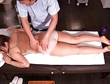 Masseur enjoys rubbing woman's pussy during massage picture 15