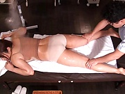 Masseur enjoys rubbing woman's pussy during massage