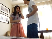 Beautiful Japanese cutie enjoys a sensual titty caress