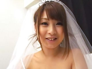 Gorgeous Asian bride seductively teases in her wedding dress