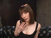 Suzumira Airi teases while in a sexy black dress