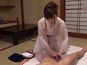 Woman in a kimono is sucking a hard dick