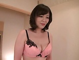 Cute Asian beauty enjoys fisting in stockings