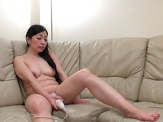 Nude amateur caught masturbating with toys on the couch