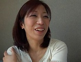 Appetizing Asian lassie takes on a huge dick picture 14