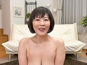 Mature Enshiro Hitomi spreads to show her gaping cunt