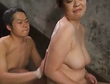 Horny Asian chick enjoys a soapy sex session picture 12