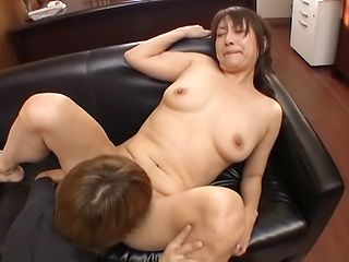 Busty Tokyo mature fucked on the couch in naughty modes