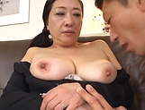 Sexy Japanese milf severe sex on the couch with young man picture 11