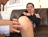 Sexy Japanese milf severe sex on the couch with young man picture 13