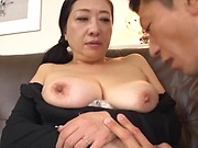 Sexy Japanese milf severe sex on the couch with young man