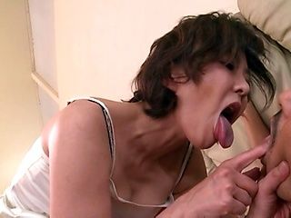 Racy Japanese mature giving a handjob