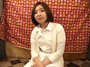Asian nurse kneels to suck a patient's dick