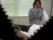Hot Japanese nurse blows a cock and gives a handjob in her office