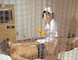 Super luscious Japanese nurse massages a cock and bounces on it hard picture 13