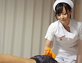 Super luscious Japanese nurse massages a cock and bounces on it hard picture 6