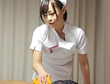 Super luscious Japanese nurse massages a cock and bounces on it hard picture 8