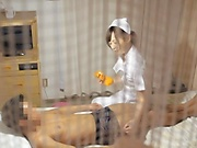 Super luscious Japanese nurse massages a cock and bounces on it hard