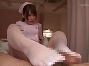 Nurse in white stockings Momozono Mirai gives a foot job