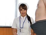Oversexed Japanese nurse sucks a cock and masturbates her twat picture 12