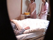 Two horny Tokyo nurses go for their patient's dick in a mff action