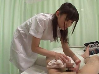 Hot Tokyo nurse is playng with a dick