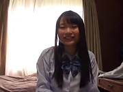 Teen Japanese schoolgirl in a swimsuit gets her pussy creamed