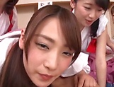 A group of crazy Japanese babes fuck a submissive guy really hard picture 13