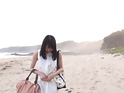 Young Japanese girl Suzukawa Ayane swallows cum on the beach