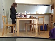 Hot milf using a dildo in the kitchen