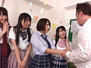 Four wild Japanese schoolgirls give a handwork and fuck rough