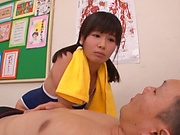 Petite schoolgirl is giving a blowjob