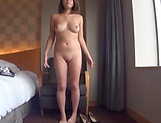 Beautiful Asian babe in a raunchy solo tease action picture 15