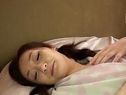 Beautiful Asian hottie showcases her wet bushy muff