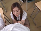 Japanese teacher Maijima Akari gives a blowjob in the classroom picture 13