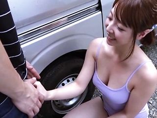 Japanese woman kneels before cock to suck it a little bit