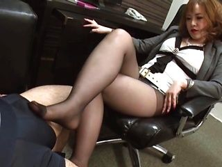 Cute Japanese amateur girl gives a foot work and an oral job in the office
