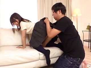 Lovely looking Japanese schoolgirl gets her shaved snatch creamed